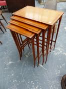 AN EDWARDIAN INLAID SATINWOOD NEST OF FOUR TABLES, TAPERED LEGS.
