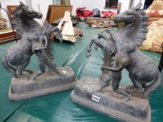 A PAIR OF SPELTER MARLEY HORSES AFTER COUSTOU, EACH REARING BESIDE THEIR HANDLERS. H 40cms.