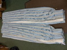 A PAIR OF PALE BLUE STRIPE PATTERN LINED AND INTERLINED CURTAINS.