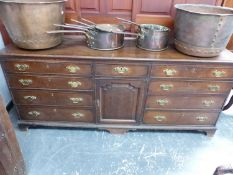 AN 18th.C.OAK AND CROSSBANDED DRESSER WITH ARRANGEMENT OF NINE DRAWERS AND CENTRAL PANEL DOOR