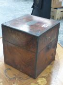 A VICTORIAN BRASS CORNERED WALNUT BOX FOR FOUR DECANTERS, THE HINGED LID INSET WITH PRESENTATION