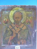 A RUSSIAN ICON PAINTED WITH ST NICHOLAS HOLDING A HOLY BOOK, ROUNDELS OF ST MARY AND JESUS ABOVE HIS