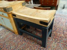 A VINTAGE BUTCHER'S BLOCK ON PAINTED PINE STAND. W.90 x 40cms.