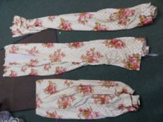 THREE VARIOUS PAIRS OF FLORAL PATTERN LINED AND INTERLINED CHINTZ CURTAINS.