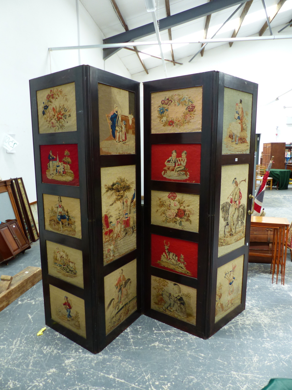 Lot 2430 - A LARGE VICTORIAN ROSEWOOD FRAMED FOUR FOLD SCREEN INSET WITH NEEDLEPOINT PANELS. EACH SECTION 62