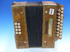 AN ANTIQUE CESARE PANGOTTI ACCORDION WITH BONE STOPS AND THE WOODEN ENDS INLAID WITH MULTI-