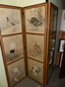 A JAPANESE THREE FOLD SCREEN, EACH FOLD WITH THREE BAMBOO FRAMED WATERCOLOURS OF BIRDS, SIGNED AND