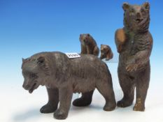 FOUR VARIOUS BLACK FOREST CARVED WOODEN BEARS, THE TALLEST STANDING ERECT. H 27cms.
