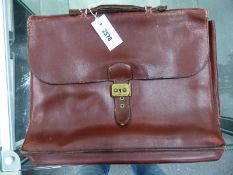AN HERMES BROWN SOFT LEATHER BRIEF OR DOCUMENT CASE, THE FOLD OVER FLAP LOCKING THE THREE