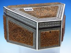 AN INDIAN CARVED WOOD AND INLAID STATIONERY BOX, RELIEF CARVED WITH OVALS OF SARUMAN, RAMA, SITA AND