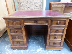 A GOOD MID VICTORIAN ROSEWOOD PEDESTAL DESK WITH ARRANGEMENT OF NINE DRAWERS AND DUMMY DRAWERS