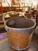 A COPPER CYLINDRICAL COAL BUCKET, TUBULAR HANDLE. Dia. 34cms.