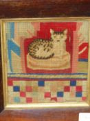 A BERLIN WOOL WORK PICTURE OF A CAT ON A CUSHION, THE ROSEWOOD FRAME. 28.5 x 26.5cms. TOGETHER