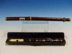 A CASED IVORY AND ROSEWOOD PICCOLO TOGETHER WITH ANOTHER SLIGHTLY LARGER IN ROSEWOOD