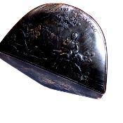 A 19TH CENTURY HORN SNUFF BOX OF NAPOLEAN HAT FORM AND DECORATED WITH NAPOLEON AT ST HELENA.