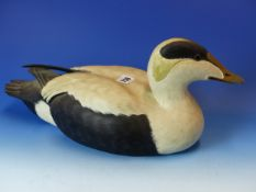 A CARVED AND PAINTED DUCK DECOY, STAMPED MIKE WOOD ON THE BASE. L. 44cms.
