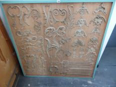 A PAIR OF DECORATIVE MOULDING SAMPLE BOARDS WITHIN SQUARE PAINTED FRAMES. H. 123 x W. 123cms.