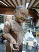 AN INTERESTING ANTIQUE CARVED AND PAINTED ASIAN STANDING FIGURE OF A BOY. OVERALL HEIGHT 81cms.