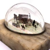AN ANTIQUE FOLK ART MINIATURE DIARAMA OF SOLDIERS BEFORE A HALF TIMBER BUILDING AMIDST TREES . ON