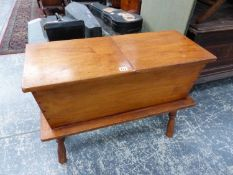 AN AMERICAN MAPLE HINGED TOP WORK BOX ON TURNED LEG STAND. H. 62 x W. 82cms.