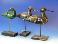 A COLLECTION OF NINE FOLK ART CARVED AND PAINTED FIGURES OF BIRDS ON STANDS. H. OF LARGEST 26cms (