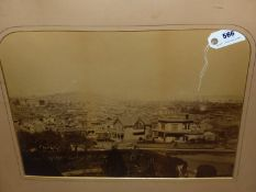 A LARGE VINTAGE PHOTOGRAPH OF A COLONIAL PORT, POSSIBLY AMERICAN. SHAPED MOUNT, UNFRAMED. 39 x