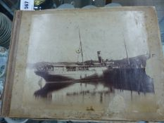 AN INTERESTING VINTAGE PHOTOGRAPH ALBUM CONTAINING IMAGES OF A COASTAL VOYAGE, TOGETHER WITH VARIOUS