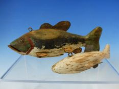 TWO ANTIQUE CARVED WOOD AND WEIGHTED FISHING LURES TOGTHER WITH A WORKED BONE IMPLEMENT.