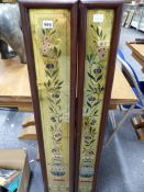 TWO SIMILAR VICTORIAN FRAMED GLASS PANELS, EACH WITH AESTHETIC POLYCHROME FLORAL DECORATION ON A