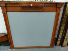 A VINTAGE CARVED AND INLAID OAK NOTICE BOARD. H. 110 x W. 121cms.
