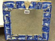 A DECORATIVE SMALL MIRROR FRAMED WITH VICTORIAN BLUE PATTERNED CHINA FRAGMENTS. H. 32.5 x W. 31cms.