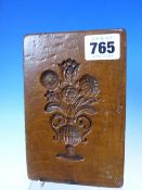 AN ANTIQUE CARVED WOOD DOUBLE SIDED MOULD.15 CM WIDE