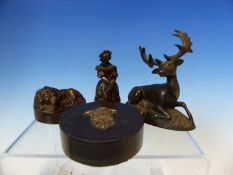 A BRONZE PAPERWEIGHT IN THE FORM OF A STAG , ANOTHER OF A SLEEPING LION, A BRONZE FIGUARAL CANDLE