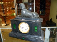 A LATE VICTORIAN SLATE EGYPTIAN REVIVAL MANTEL CLOCK, A SPHINX ABOVE ENAMEL DIAL WITH FLANKING