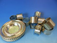 A SET OF SIX HALLMARKED SILVER NAPKIN RINGS, TOGETHER WITH FOUR GADROONED RIM SIDE DISHES ETC,