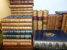 A COLLECTION OF BOOKS AND BINDINGS TO INCLUDE LEATHER UNIFORM SETS ETC.
