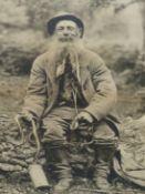 "A VINTAGE PORTRAIT PHOTOGRAPH OF ""BRUSHER MILLS"", BRITAIN'S LAST PROFESSIONAL SNAKE CATCHER, A"
