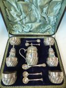 A SILVER HALLMARKED CASED CONDIMENT SET TO INCLUDE TWO PEPPERS, FOUR SALTS AND A MUSTARD POT.