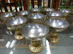 A SET OF TEN ENAMELLED AND CHASED BRASS INDIAN GOBLETS WITH SILVERED INTERIORS. H. 10cms.