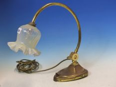 AN ART NOUVEAU BRASS TABLE LAMP WITH OPAQUE GLASS SHADE.