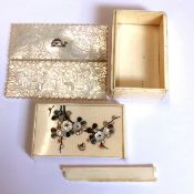 AN ANTIQUE JAPANESE IVORY SMALL BOX , THE LID INLAID WITH MOTHER OF PEARL TOGETHER WITH TWO GAMING