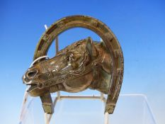 """A FRENCH CAST NICKEL PAPERWEIGHT OF HORSES HEAD WITHIN HORSESHOE INSCRIBED VERSO """"J.P"""" PARIS -146"""