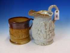 A VICTORIAN POTTERY JUG WITH FIGURAL DECORATION, TOGETHER WITH A LARGE STONEWARE MUG DECORATED