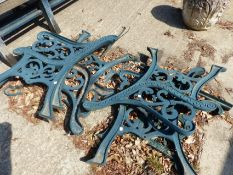 THREE PAIRS OF MATCHING GARDEN BENCH ENDS AND A SIMILAR PAIR OF TABLE ENDS.