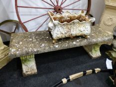 A RECONSTITUTED STONE GARDEN SEAT. W.140 x D.38 x H.42cms.
