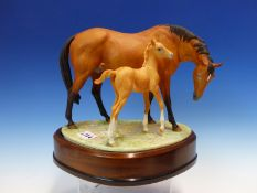 A 1970 ROYAL WORCESTER GROUP OF PRINCESS GRACE & FOAL MODELLED BY DORIS LINDNER. W 26cms.