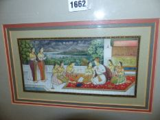THREE INDIAN MINIATURES ON IVORINE EACH PAINTED WITH A DIGNITARY SEATED ON A TERRACE DRINKING WITH A