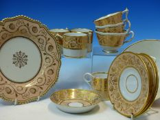 FLIGHT, BARR AND BARR TEA AND COFFEE WARES GILT WITH STRAWBERRIES ON A SALMON PINK RIM BAND TOGETHER