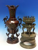A JAPANESE BROWN PATINATED BRONZE VASE WITH PEACOCK HANDLES. H 39cms. A BRONZE TALL STAND WITH