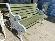 A PAIR OF WOOD SLAT GARDEN BENCHES WITH CAST IRON END SUPPORTS.